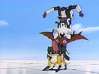The Decepticon Headmasters stand on top of each other