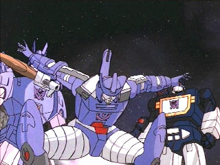 Galvatron squats in front of Cyclonus and Soundwave