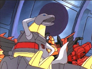 Grimlock scratches his head while sitting down