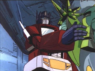 Optimus pats a Quintesson on the side of its head