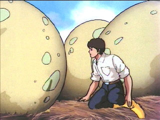Spike with some giant eggs in a nest