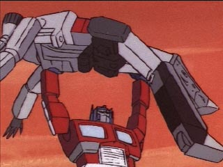 Optimus Prime holds Megatron over his head