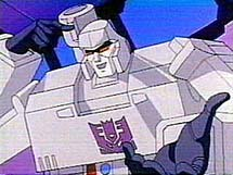 Megatron points at his head