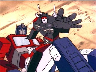 Frenzy on top of Optimus Prime