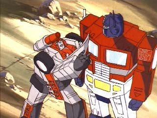 Red Alert pulling on Prime's arm
