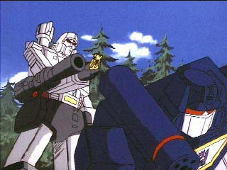 Megatron stands behind Soundwave w/ key in hand