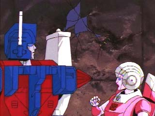 Arcee looks shocked at Ultra Magnus' missile