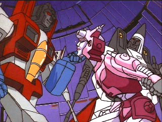 Starscream holds Elita One's chin
