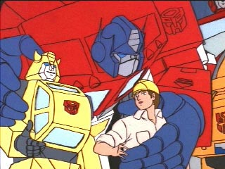 Optimus with arms around Bumblebee and Spike
