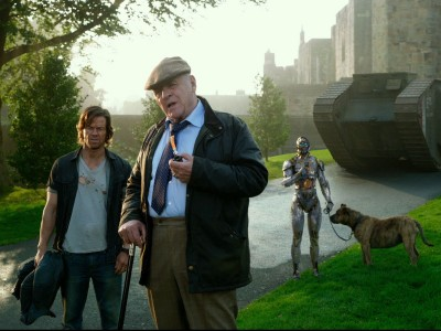 Cade Yeager and Sir Edmund Burton discuss things with Cogman and Burton's dog