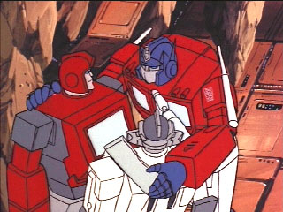 Optimus w/ arms around Autobots