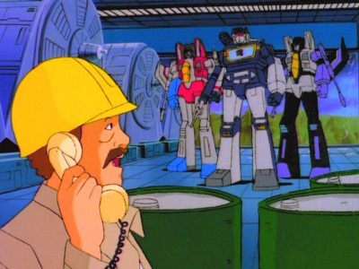 Worker on phone by Decepticons