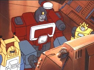 Perceptor talking to Bumblebee and Seaspray while working on the computer